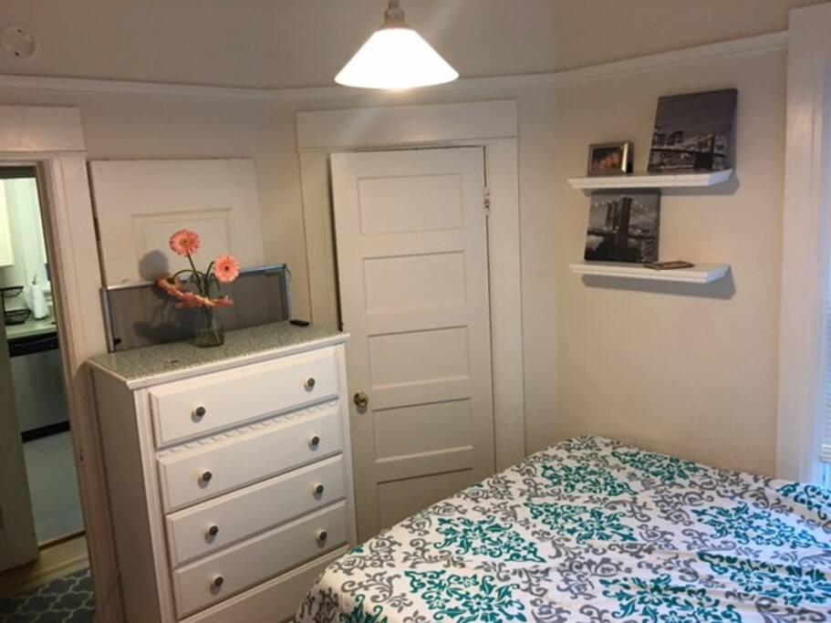 smaller bedroom with queen bed