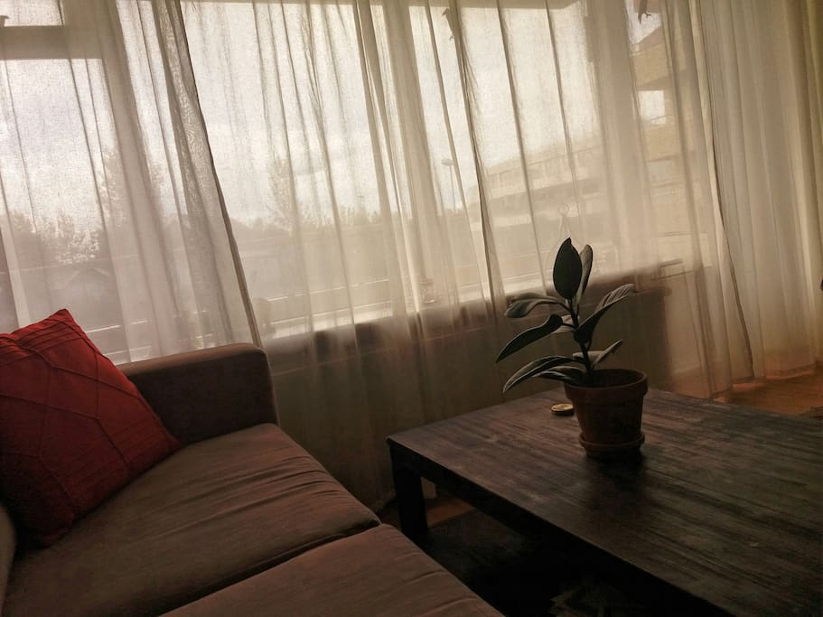 Living room by window.  Home Away - Selfoss Apartment - Home  Stay