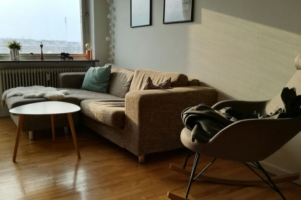 Nice and soft couch and a comfortable rocking chair