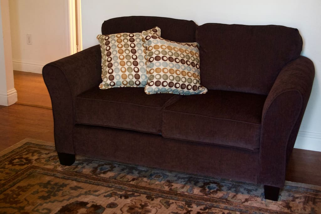There is also another full size couch in addition to the one pictured.