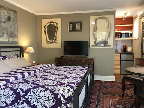 "King bed w/ ""european"" foam mattress, 39"" flat screen w/direct TV, Original Art!"