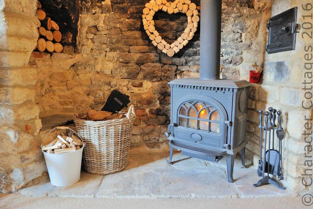 Large inglenook fireplace with log burner and old bread oven