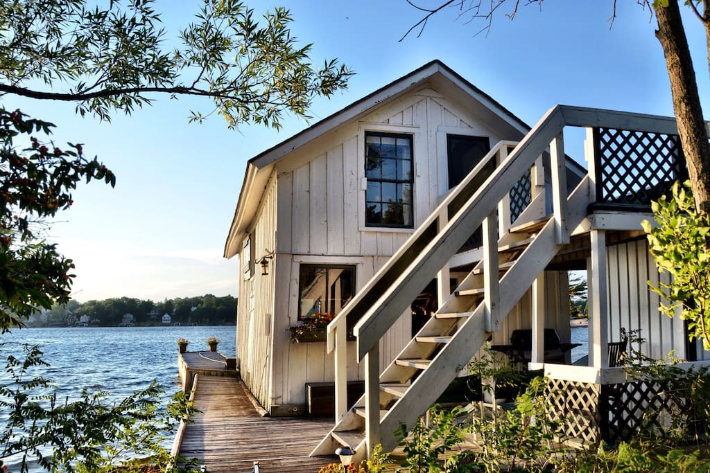 Climb the stairs to the deck and living quarters of the Boathouse. Swim off the dock in beautiful, clear, deep water.