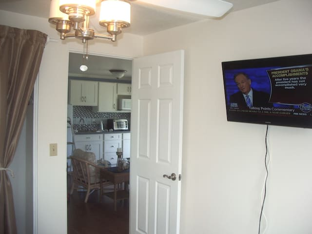 TV on wall in each bedroom