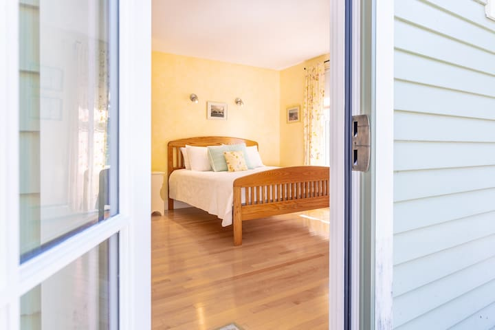 Master Bedroom with queen bed and lots of natural light.