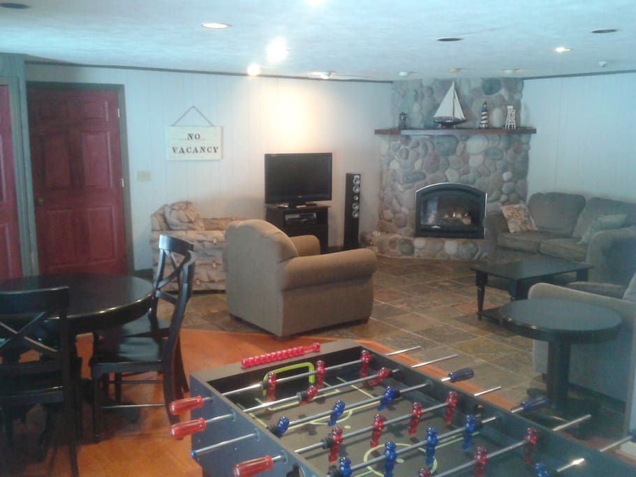 Rec./ Family room with Foosball, game table, gas fire place