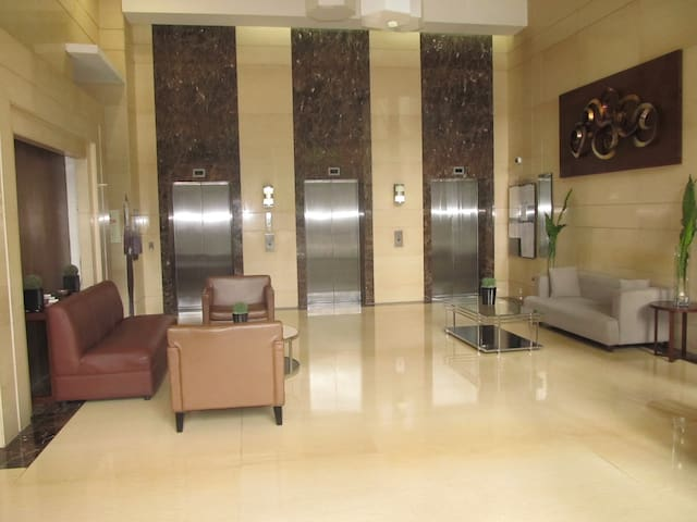 Spacious, clean, safe and a very hospitable front office personnel at the left. Perfect ambiance lobby of the Building