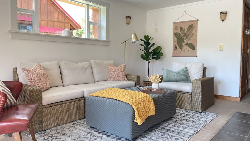The cozy living room has an ottoman that folds out into a twin size bed if needed.