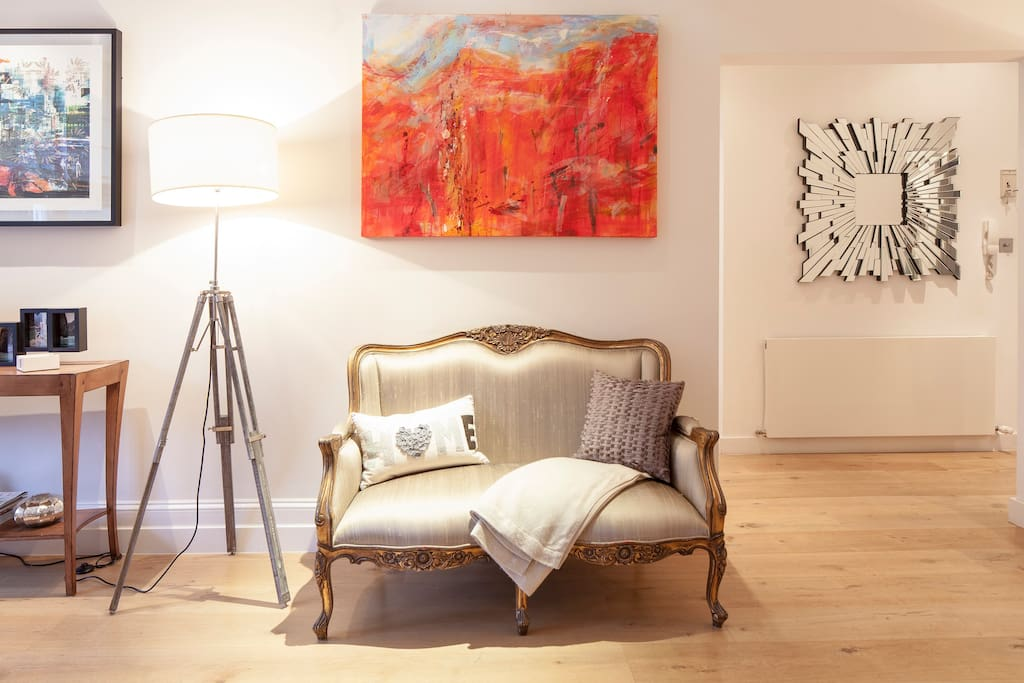 Sitting room - Chateau double armchair, I enjoy beautiful furniture and artwork.
