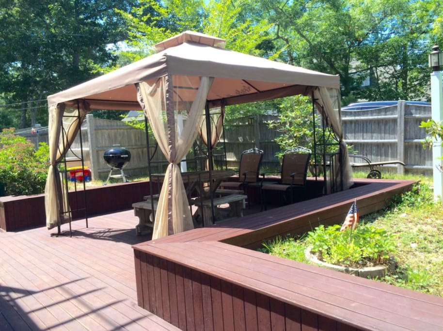 Deck with netted gazebo.