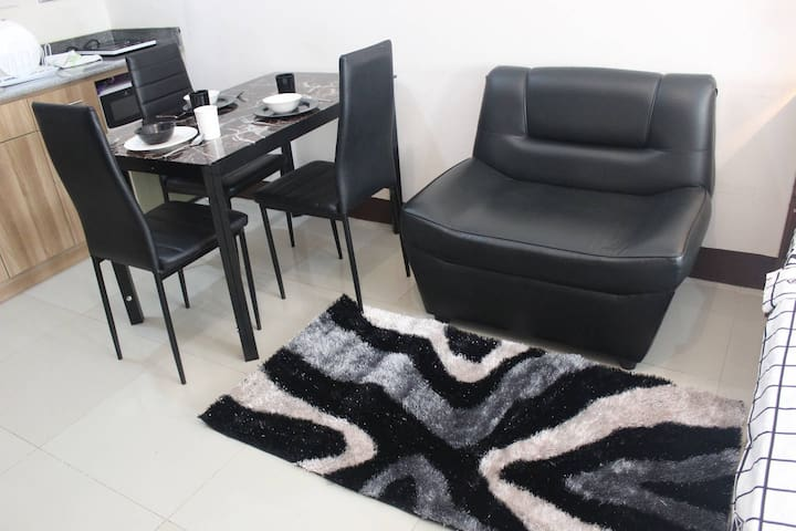 Single Couch with Carpet to Enjoy that relaxing Movie Time