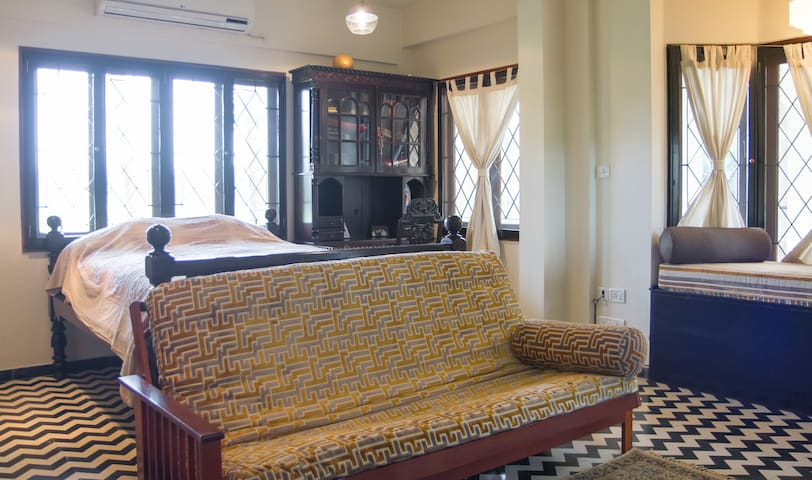 Guest queen bed and futon sofa.
