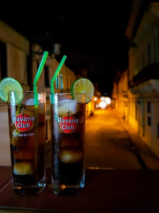 cuba libre drinks at night from our balcony