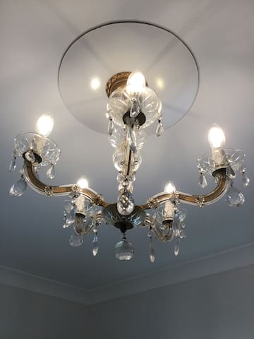Vintage chandelier in main bedroom