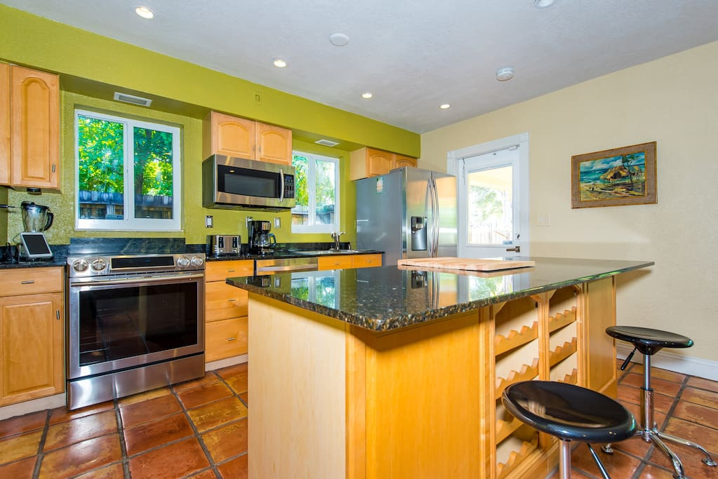 The kitchen features stainless appliances and granite counters