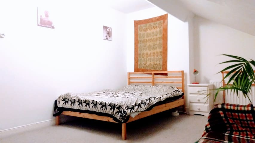 Extra large attic room can accommodate 3 people. Great for families