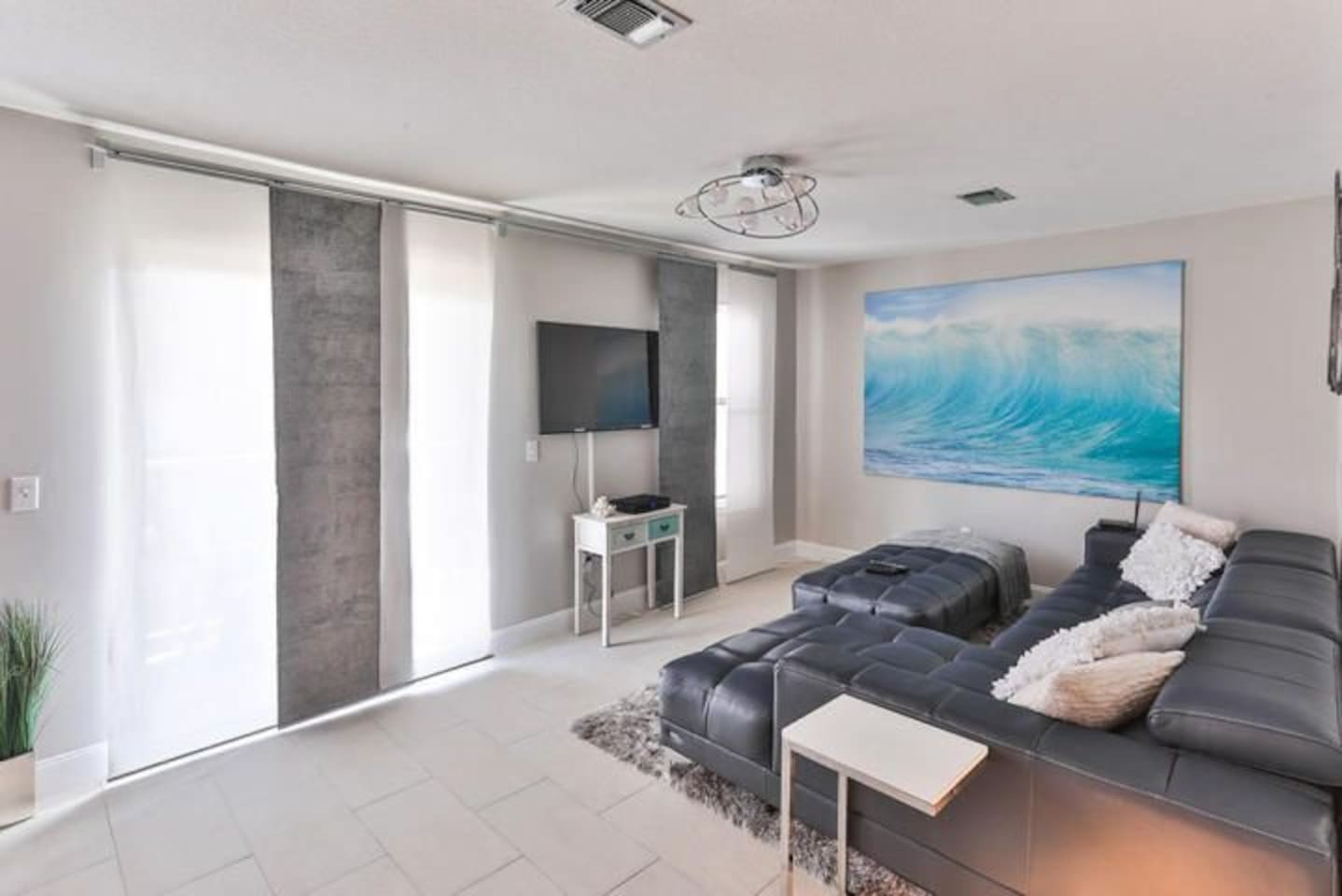 Modern style living room with balcony view of the water