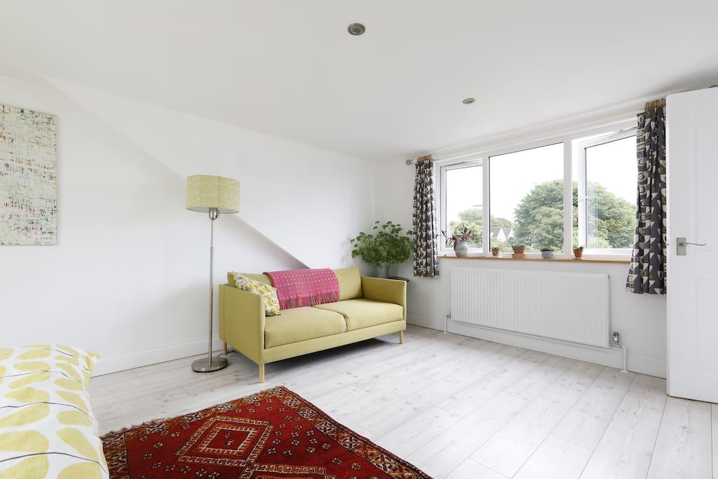 Loft bedroom with sofa