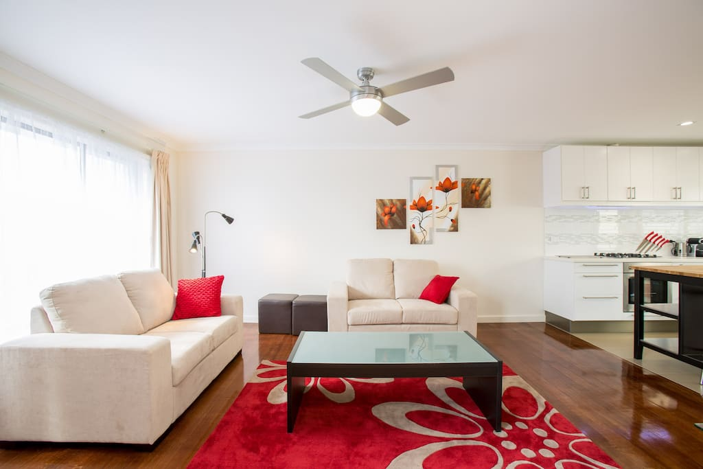 Fresh light filled open plan lounge to relax in with AC, Ceiling Fan and Gas Heating,
