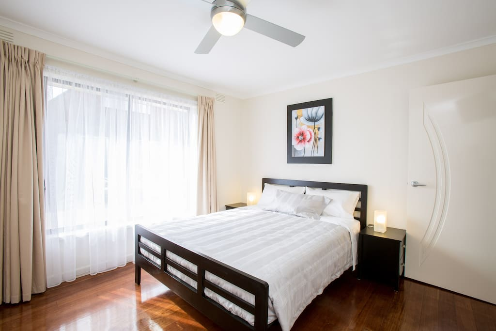 Light spacious airy bedroom 1 with ceiling fan, TV, large wardrobe, sea view.