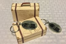 Before noon on the day of your arrival you can arrange to purchase one of our Magnolia Hotel Key Chains! They are $12 and can be waiting for you in you room. They come with a unique suitcase gift box too.
