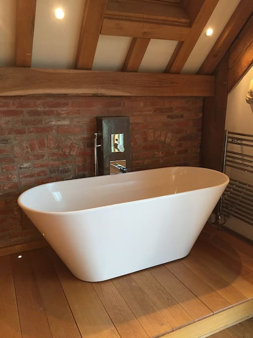 The Luxury bath that happily fits 2 in the main bedroom on its own oak platform
