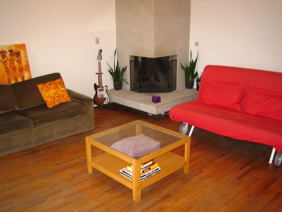 This is the livingroom with my red couch/sleeper.(Fireplace can't be used, sorry!)
