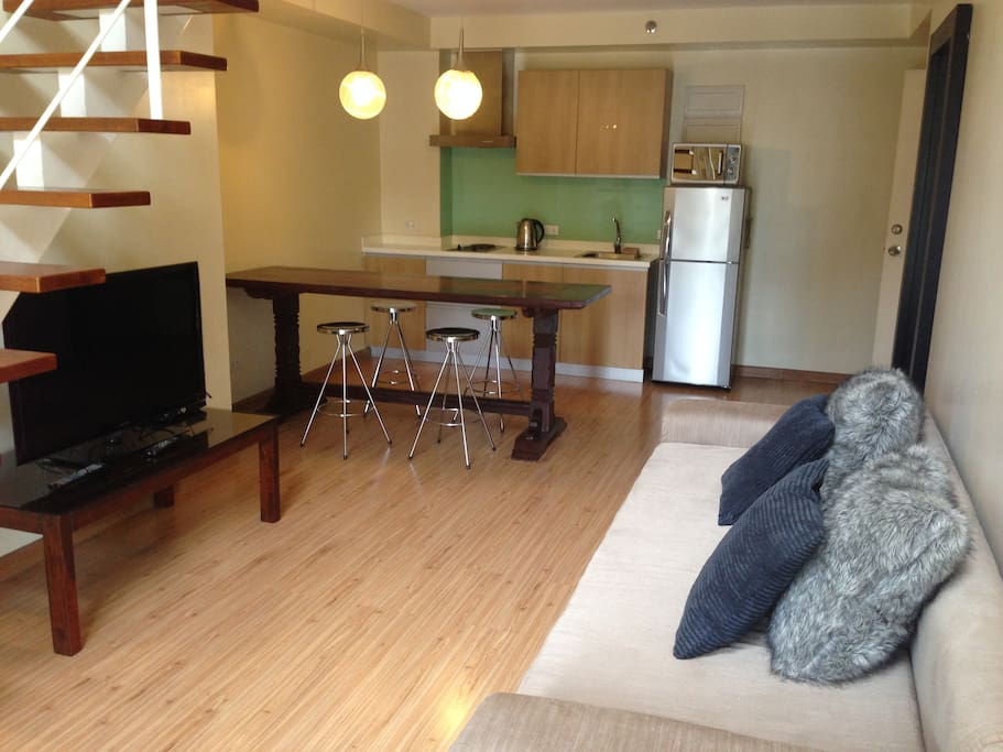 with flat screen tv and long wooden table