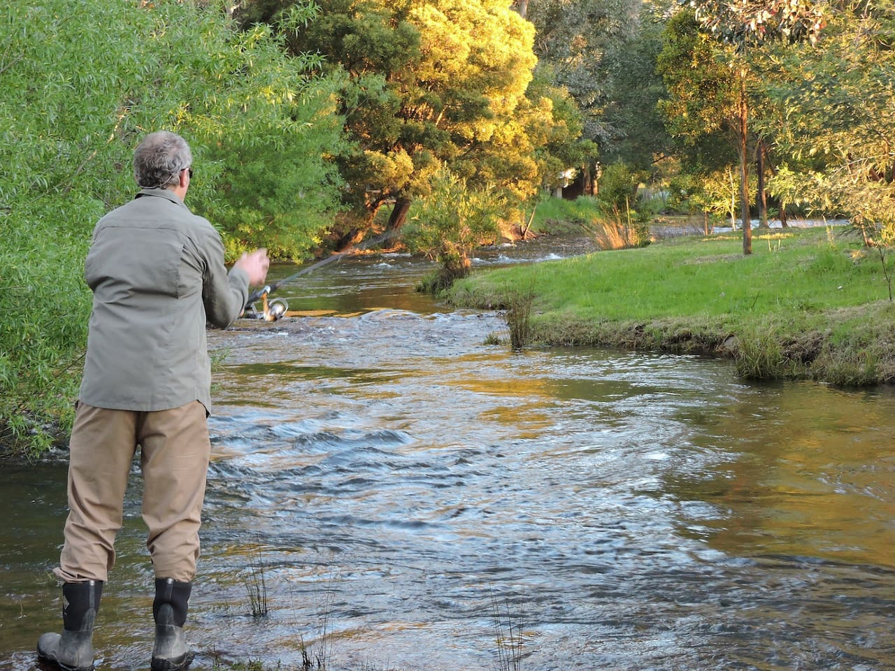 Fishing in the river as it flows past the property.