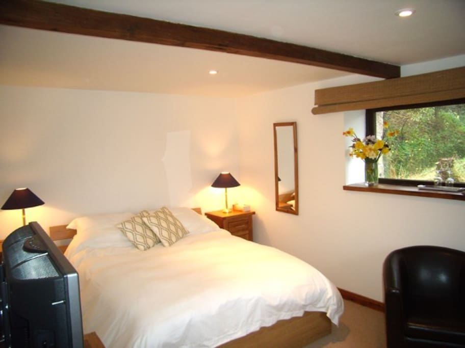 King size bed and views overlooking the garden and East Looe Valley.