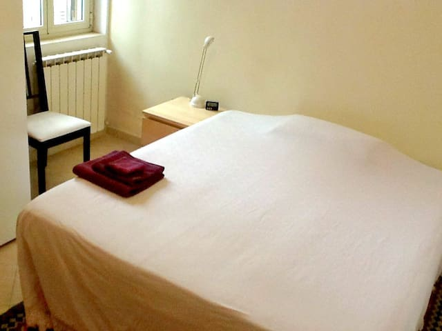 Bedroom 2: A comfortable double bed with window over looking the Roman Aqueduct.