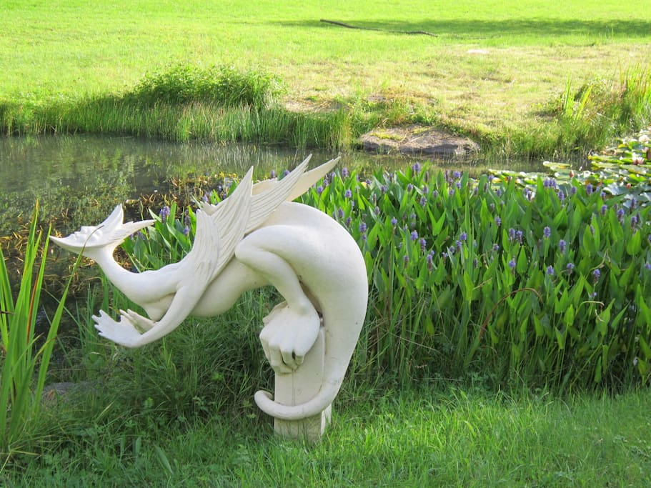 Four acres of woodlands and water, formal flower-beds and interesting sculpture.