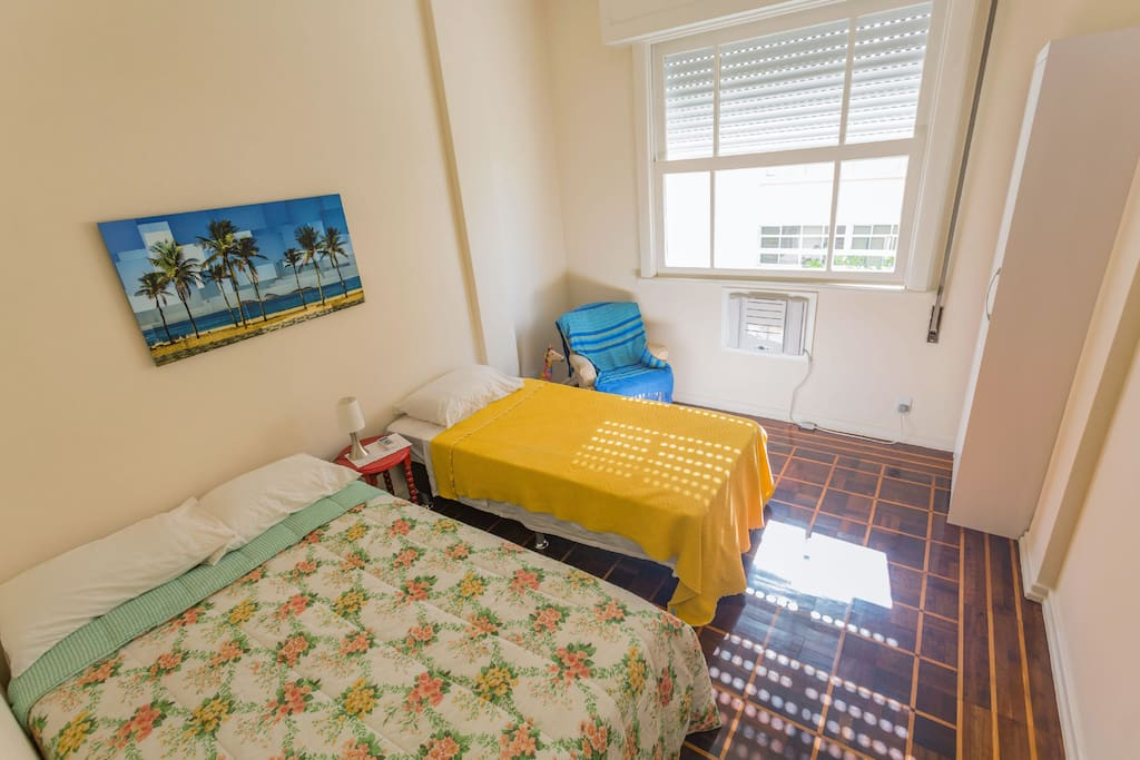 This is your room! One double bed + one single bed, A/c, armchair, wardrobe and beach view!