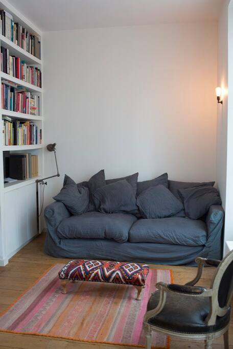 Comfortable sofa provides an extra bed for one person