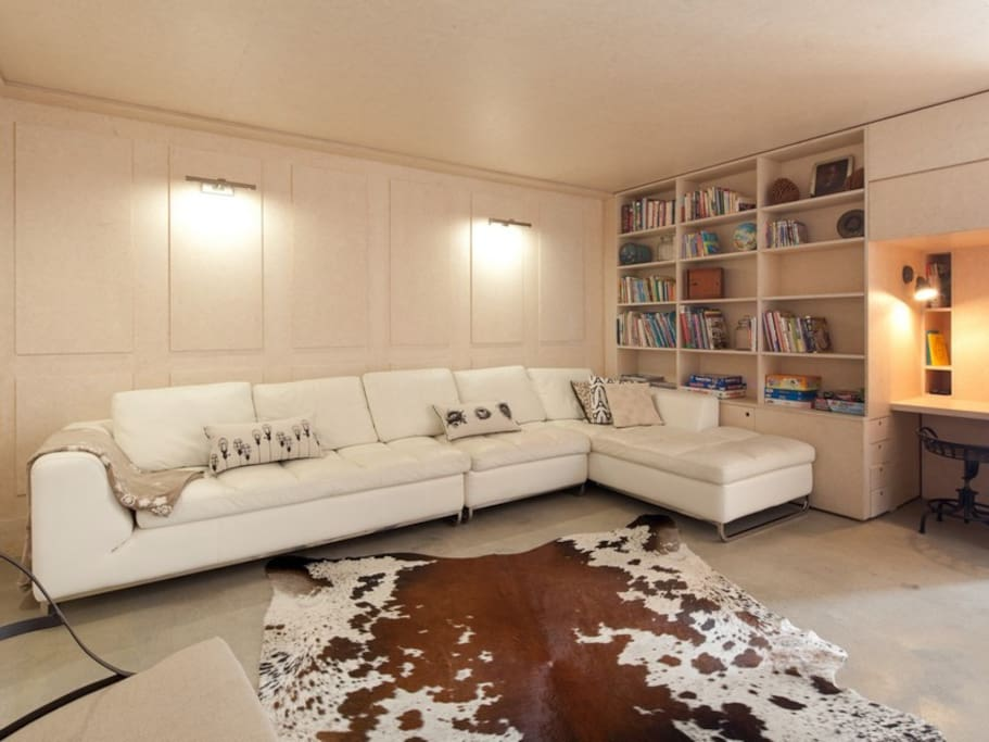 relax, put your feet up....you deserve it! lounge/ media room with library and games for kids