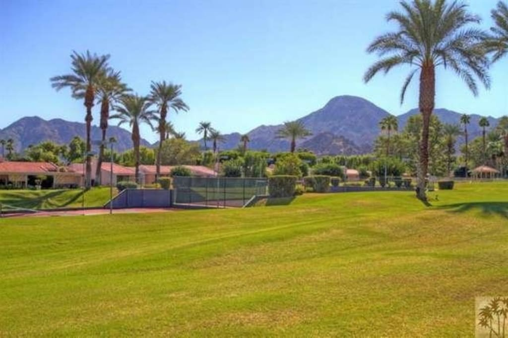 Spacious lawn overlooking the tennis courts and the mountains of Indian Wells.