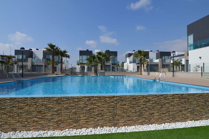 Modern 4-room apartment with private terrace and shared swimming pool
