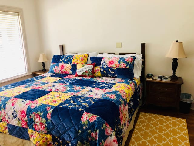 King size bed in Master Bedroom with Pioneer Woman bedding.