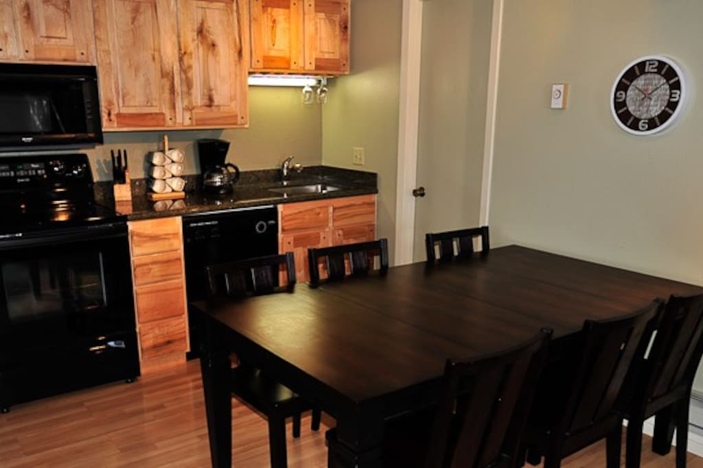 Clean and simple kitchen.  Granite counters, maple cabinetry, wood flooring.