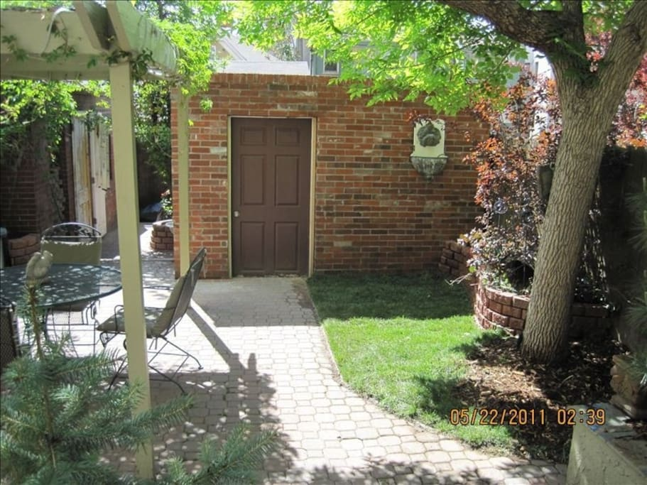 Back yard, patio/pergola with lights, seating for 7