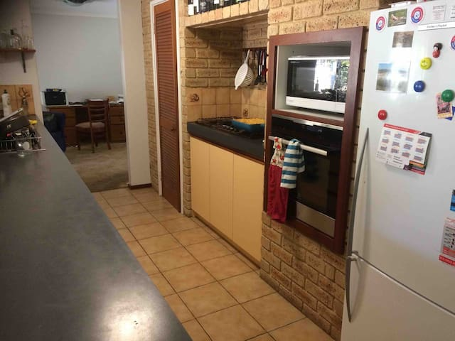 Kitchen Includes microwave, oven, and and gas stove top
