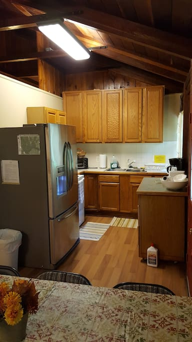 Kitchen with full oven and fridge/freezer