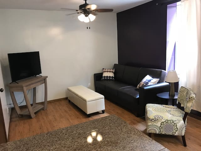 """Sitting area with 44"""" TV."""
