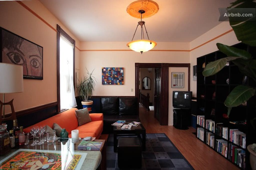 Flat has an open floor plan and high ceilings