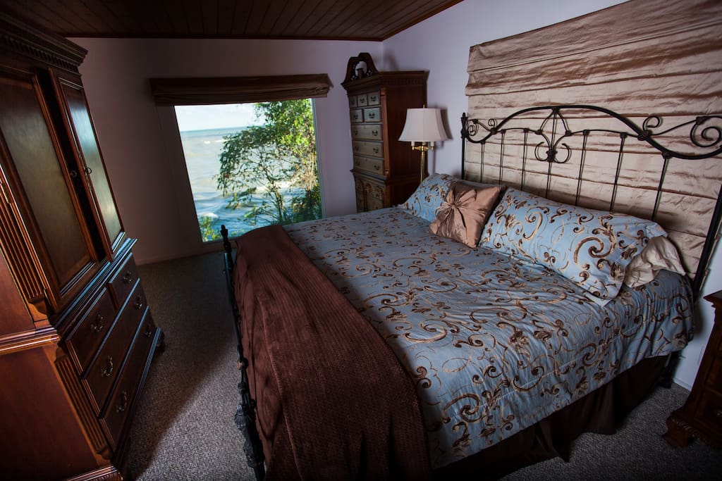 View of the beach through the master bedroom picture window,