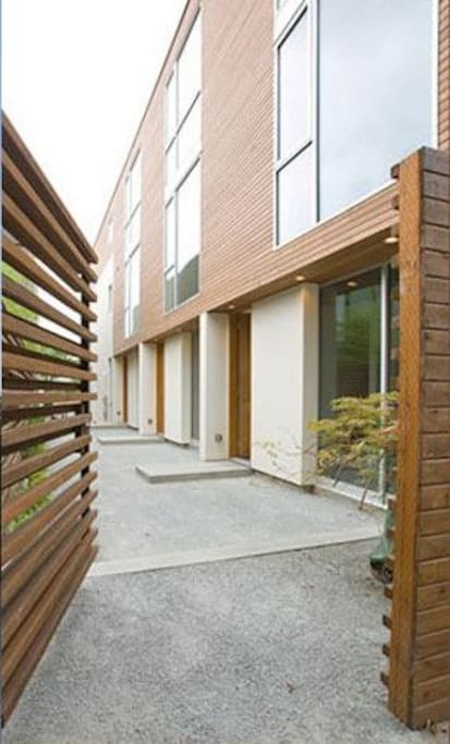 Private walkway keeps unit quiet and secure.