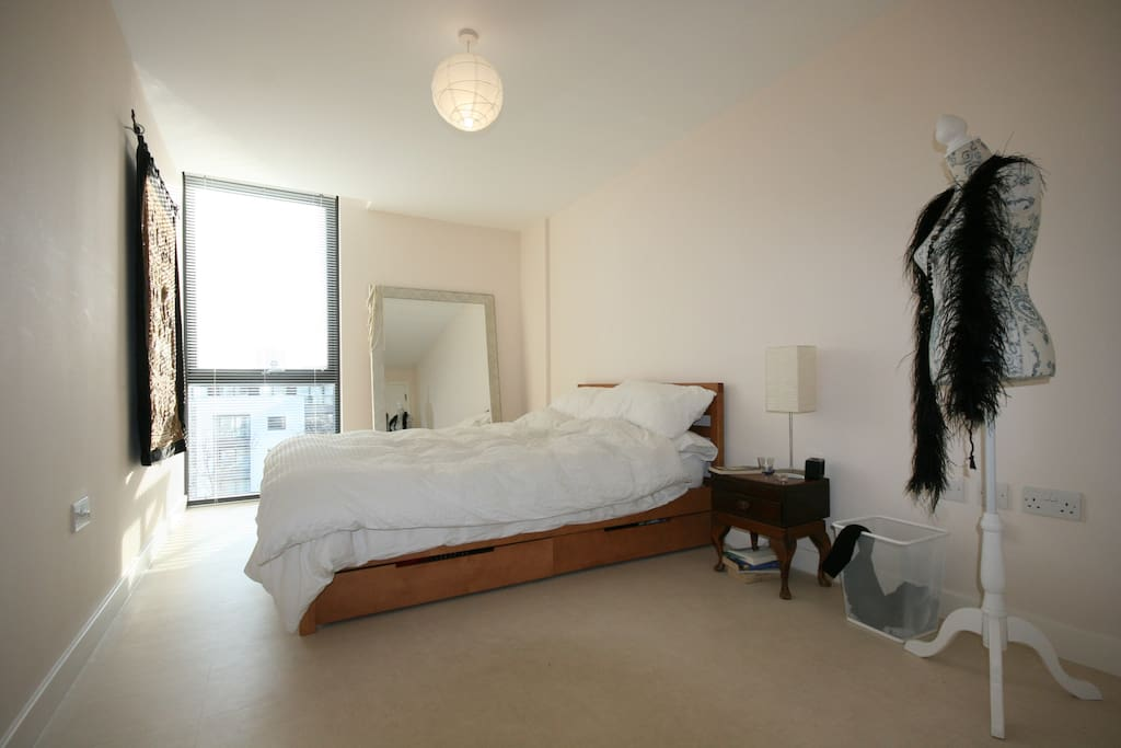 Large Light Lovley Double Bedroom Floor to ceiling window with Canal Views. built in wardrobe for hanging clothes.