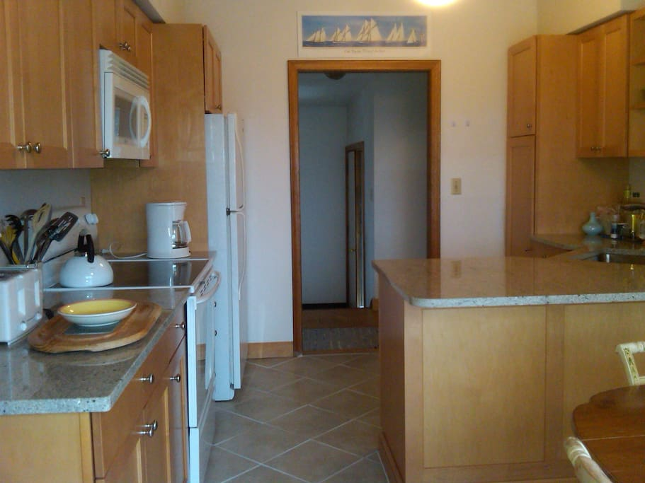 Completely renovated kitchen  with indoor and outdoor dining areas!