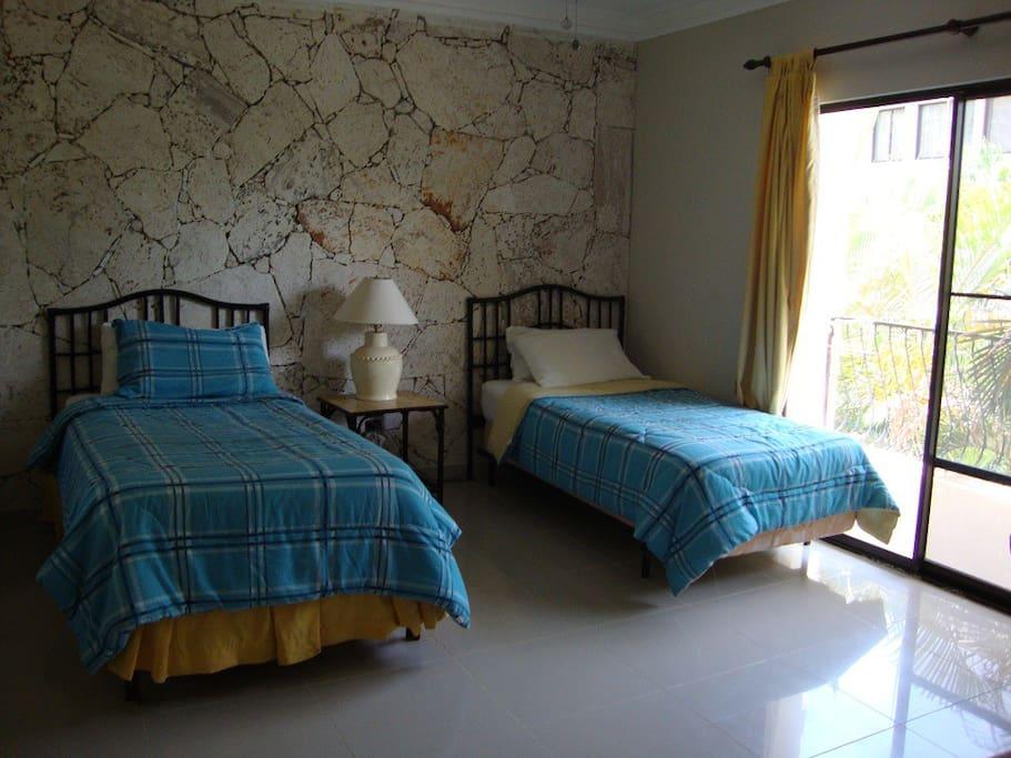 2nd bedroom with en suite bathroom and balcony