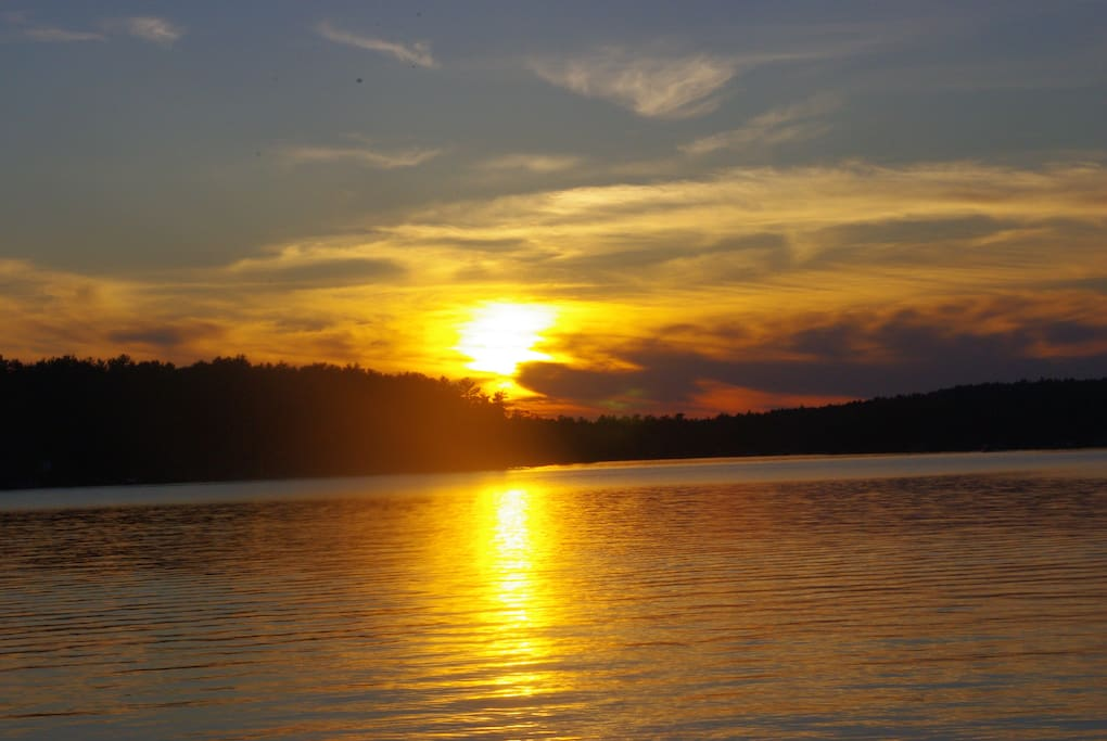 Enjoy spectacular sunsets from lakeside deck.